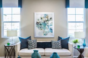 Choose throw pillows for a sofa with a center focus